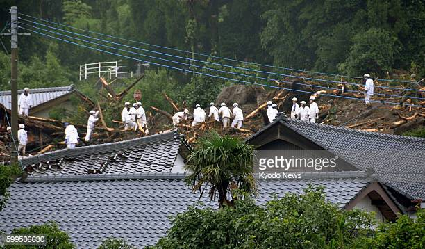 Minamiaso Japan Rescue workers search for people who have gone missing at the site of a landslide in Minamiaso Kumamoto Prefecture on July 12 2012...