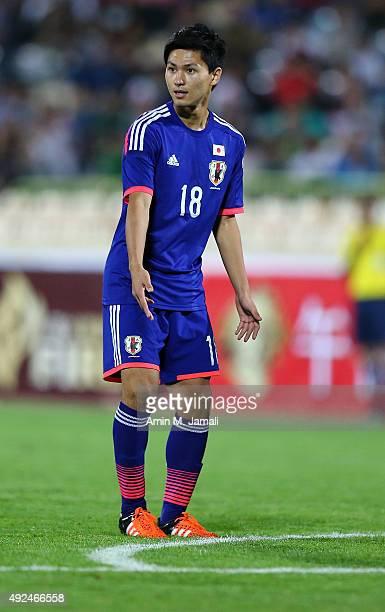 Minamino Takumi looks on during the international friendly match between Iran and Japan at Azadi Stadium on October 13 2015 in Tehran Iran