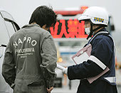 Minamisoma Japan A police officer explains to a driver about a noentry zone set around the crippled Fukushima Nuclear Power Station on Route 6 in...