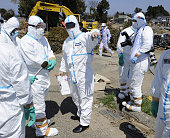 Minamisoma Japan Chief Cabinet Secretary Yukio Edano in protective gear visits an area under the government's evacuation order where search...