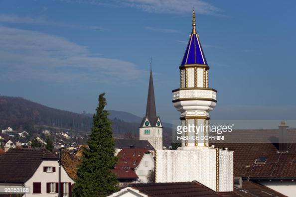 A minaret installed on the roof of a Turkish cultural centre is seen with a church in the background on November 20 2009 in Wangen bei Olten...