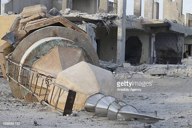 Minaret of al Hinni Mosque is destroyed in air strikes by Syrian army warplanes on the ISILheld northern city of Raqqa Syria on November 25 2014 At...