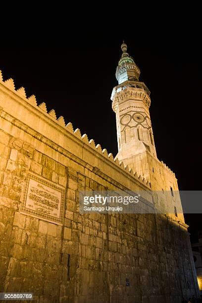 Minaret of Umayyad Mosque illuminated at night