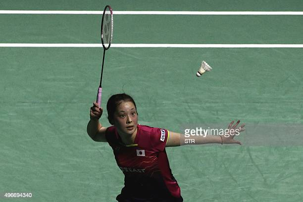 Minatsu Mitani of Japan hits a return against Zhang Beiwen of the US during their women's singles first round match at the China Open badminton...