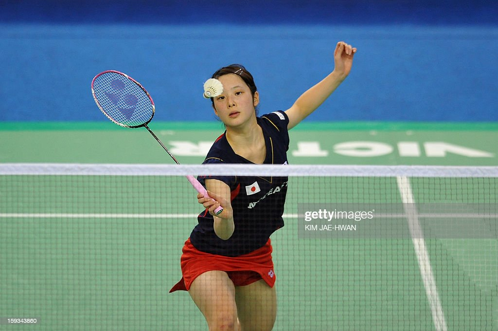 Minatsu Mitani of Japan plays a shot during her women's singles badminton match against Wang Shixian of China during the semi-finals of the Korea Open at Seoul on January 12, 2013. Wang Shixian won the match 21-11, 21-17.