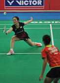 Minatsu Mitani of Japan plays against Jia Min Yeo of Singapore during their women's singles badminton match during the Asia Team Championships at...