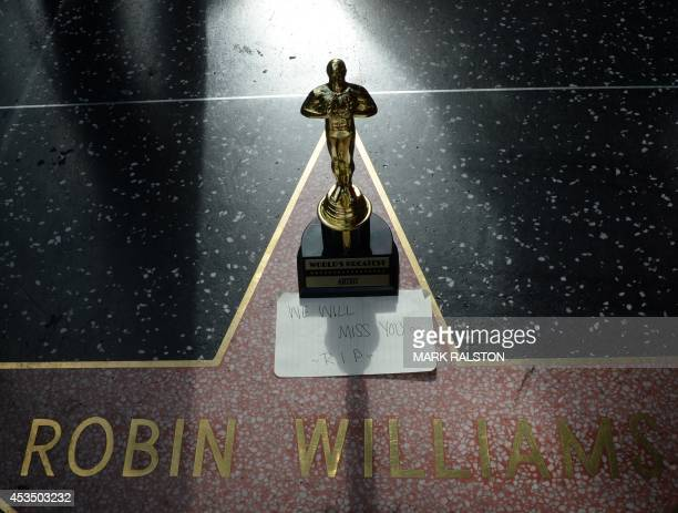 A minature Oscars statue and an 'I will miss you' note is seen at Robin Williams' star on the Hollywood Walk of Fame is seen August 11 in Hollywood...