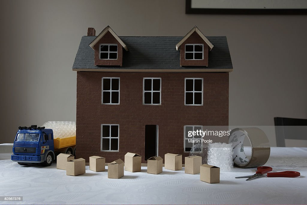 minature packing boxes outside dolls house : Stock Photo