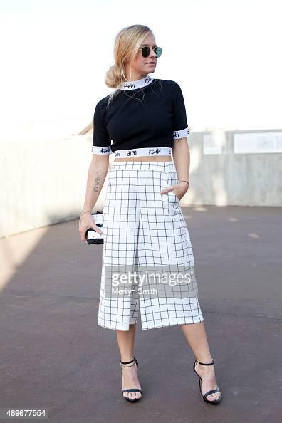 Minc Magazine Owner Morgan Ferguson wears a Ksubi top Rayban sunglasses Alice in the Eve trousers and Zara shoes at MercedesBenz Fashion Week...