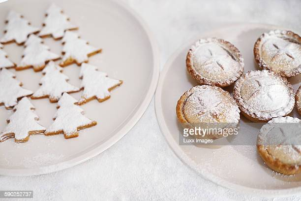 Mince pies and tree biscuits on plates