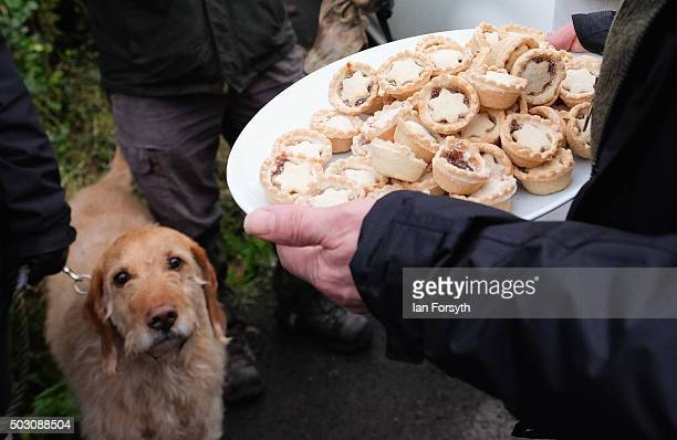 Mince pies are offered to spectators as horses riders and hounds from the Cleveland Hunt prepare to ride out on the traditional New Year's Day hunt...