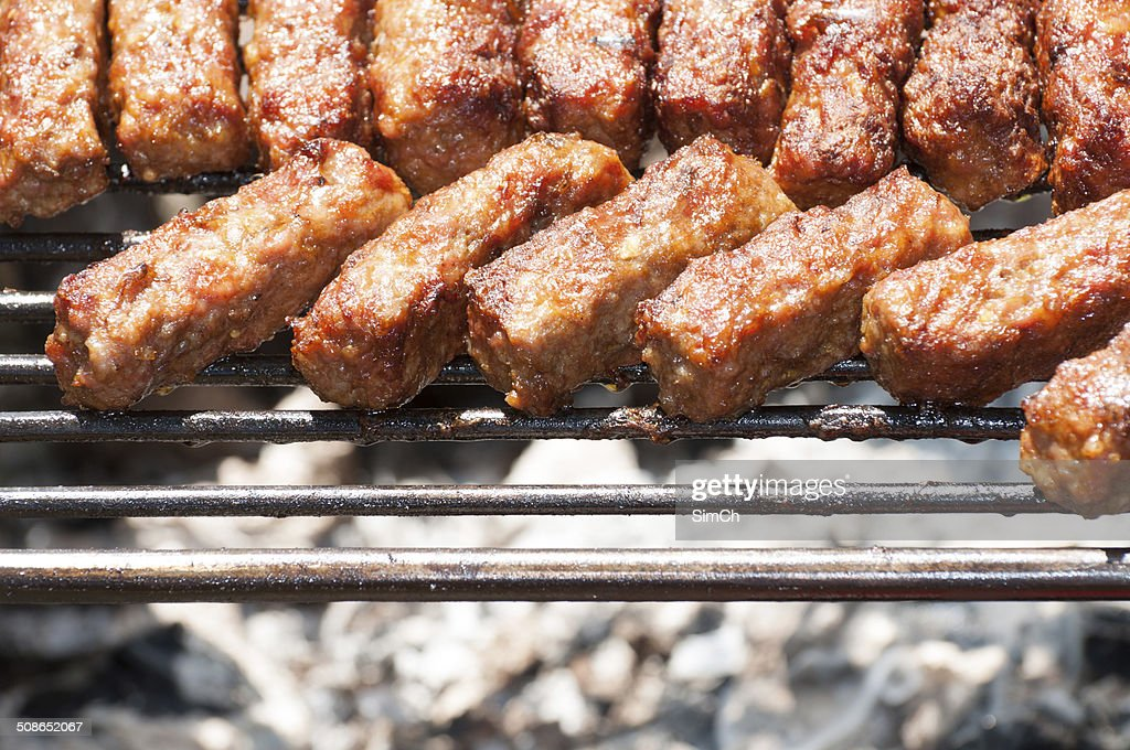 minced meat rolls on grill (traditional Romanian food) – mititei, mici : Stock Photo