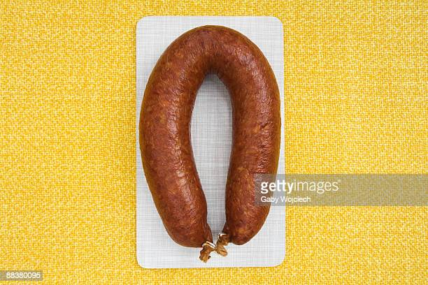 Minced pork sausage on chopping board, view from above, close-up