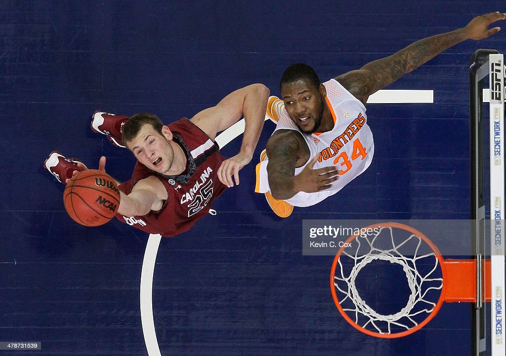 Mindaugas Kacinas #25 of the South Carolina Gamecocks battles for a rebound against Jeronne Maymon #34 of the Tennessee Volunteers during the quarterfinals of the SEC Men's Basketball Tournament at Georgia Dome on March 14, 2014 in Atlanta, Georgia.