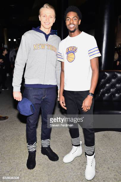 Mindaugas Kuzminskas and Justin Holiday attend Grungy Gentleman Backstage NYFW Men's on February 2 2017 in New York City