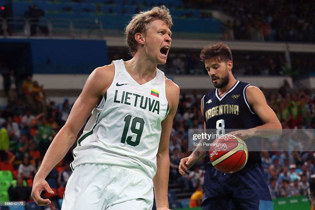 Mindaugas Kuzminskas of Lithuania celebrates after scoring against Nicolas Laprovittola of Argentina during the Men's Basketball Preliminary Round...