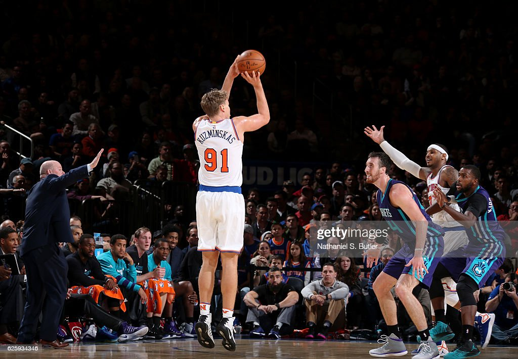 Mindaugas Kuzminskas #91 of the New York Knicks shoots the ball against the Charlotte Hornets at Madison Square Garden in New York, New York.