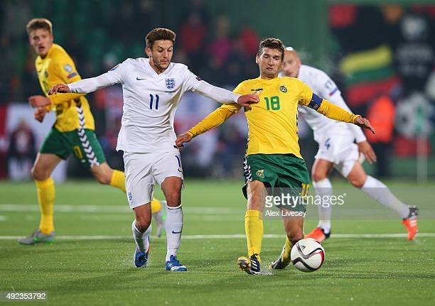 Mindaugas Panka of Lithuania holds off Adam Lallana of England during the UEFA EURO 2016 qualifying Group E match between Lithuania and England at...