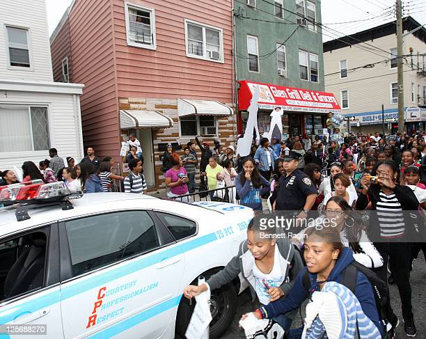 Mindless Behavior fans chase Mindless Behaviors van down the street during the celebration for Mindless Behavior's Girl album release with an instore...