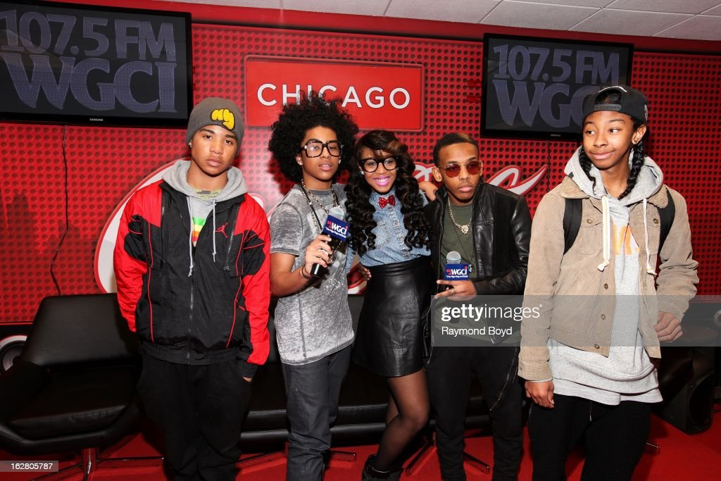 Mindless Behavior(Roc Royal, Princeton, Prodigy and Ray Ray), poses for photos with on-air personality Demi Lobo(c), in the WGCI-FM 'Coca-Cola Lounge' in Chicago, Illinois on FEBRUARY