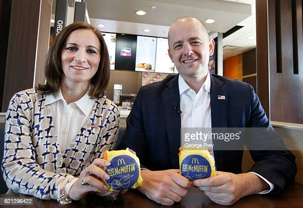 Mindy Finn running mate of US independent presidential candidate Evan McMullin hold an 'Egg McMuffin' at a McDonald's on November 5 2016 in Ephriam...