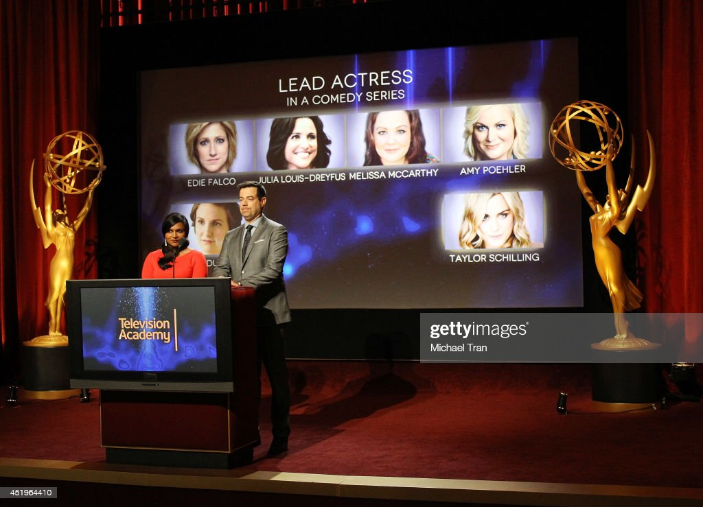 Mindy Kaling and Carson Daly announce the nominees at the 66th Primetime Emmy Awards nominations press conference held at Leonard H Goldenson Theatre...