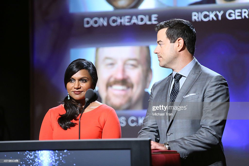 <a gi-track='captionPersonalityLinkClicked' href=/galleries/search?phrase=Mindy+Kaling&family=editorial&specificpeople=743884 ng-click='$event.stopPropagation()'>Mindy Kaling</a> and <a gi-track='captionPersonalityLinkClicked' href=/galleries/search?phrase=Carson+Daly&family=editorial&specificpeople=202941 ng-click='$event.stopPropagation()'>Carson Daly</a> announce the nominees at the 66th Primetime Emmy Awards nominations press conference held at Leonard H. Goldenson Theatre on July 10, 2014 in North Hollywood, California.
