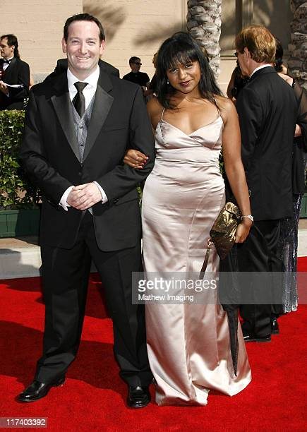 Mindy Kaling and guest during 58th Annual Creative Arts Emmy Awards Arrivals at The Shrine Auditorium in Los Angeles California United States