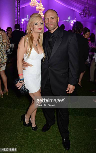 Mindy Robinson and Randy Couture attend 'The Expendables 3' private dinner and party at Gotha Night Club at Palm Beach on May 18 2014 in Cannes France