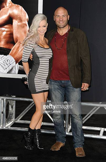 Mindy Robinson and Randy Couture attend the premiere of 'Creed' at Regency Village Theatre on November 19 2015 in Westwood California