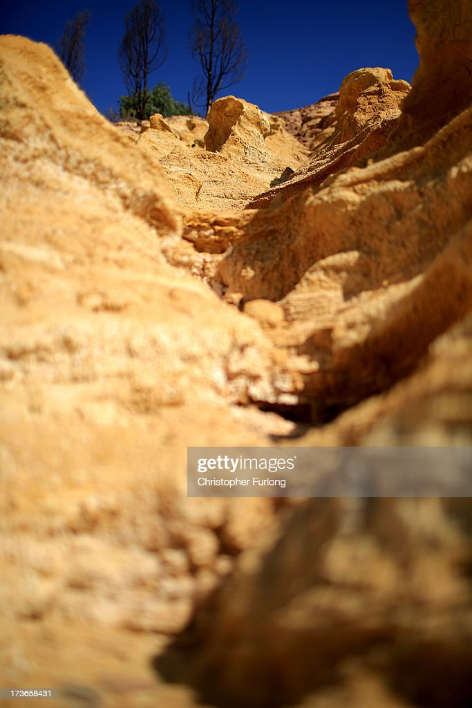 A mine dump of fine sand, the residue of crushed rock from deep mining, is eroded by the elements on July 15, 2013 in Johannesburg, South Africa. Johannesburg became the centre of gold mining in 1886 when gold was first discovered. Two government officials were sent to establish a settlement and named it Johannesburg after the first name they both shared. The gold rush lasted for over 100 years. The South African mining industry has shed more than 340,000 jobs since 1990 but is still the fifth largest gold producer in the world and has vast amounts of other minerals still to be unearthed..