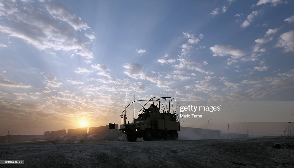 A Mine Resistant Ambush Protected (MRAP) vehicle drives past blast walls through the nearly deserted Camp Adder, now known as Imam Ali Base, on December 16, 2011 near Nasiriyah, Iraq. Around 500 troops from the 3rd Brigade, 1st Cavalry Division ended their presence on Camp Adder, the last remaining American base, and departed in the final American military convoy out of Iraq, arriving into Kuwait in the early morning hours of December 18, 2011. All U.S. troops were scheduled to have departed Iraq by December 31st, 2011. At least 4,485 U.S. military personnel died in service in Iraq. According to the Iraq Body Count, more than 100,000 Iraqi civilians have died from war-related violence.