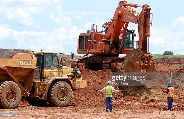 A mine worker gestures while directing a truck at a quarry at Metorex's Ruashi copper mine near Lubumbashi Democratic Republic of Congo on Friday Feb...