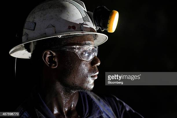 A mine worker pauses during drilling work in the underground tunnels at the Kibali gold mine operated by Randgold Resources Ltd in Kibali Democratic...