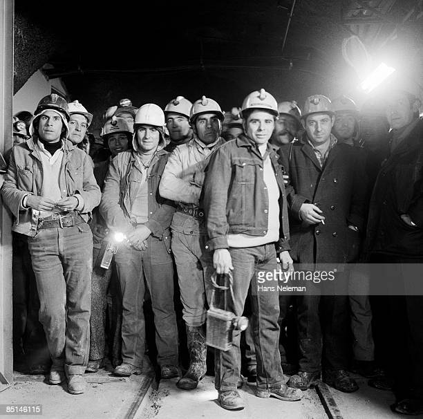 Mine workers waiting for an underground train