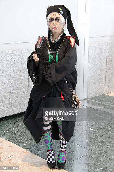 Mineoka Namiko is wearing clothing and jewellery of her own design as well as antique jewellery Harajuku patchwork graphic stockings Dangerous Nude...