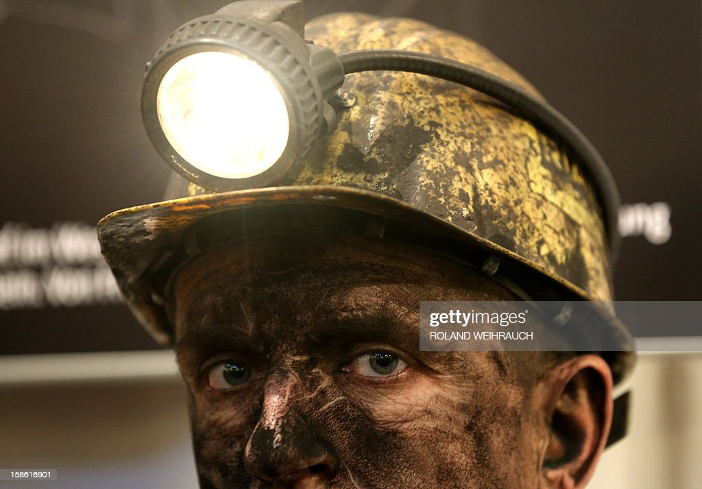 A miner attends the closing ceremony after the very last mining shift at Mine West in Kamp-Lintfort, western Germany, on December 21, 2012. The mine will be shut down after being active for around 100 years.