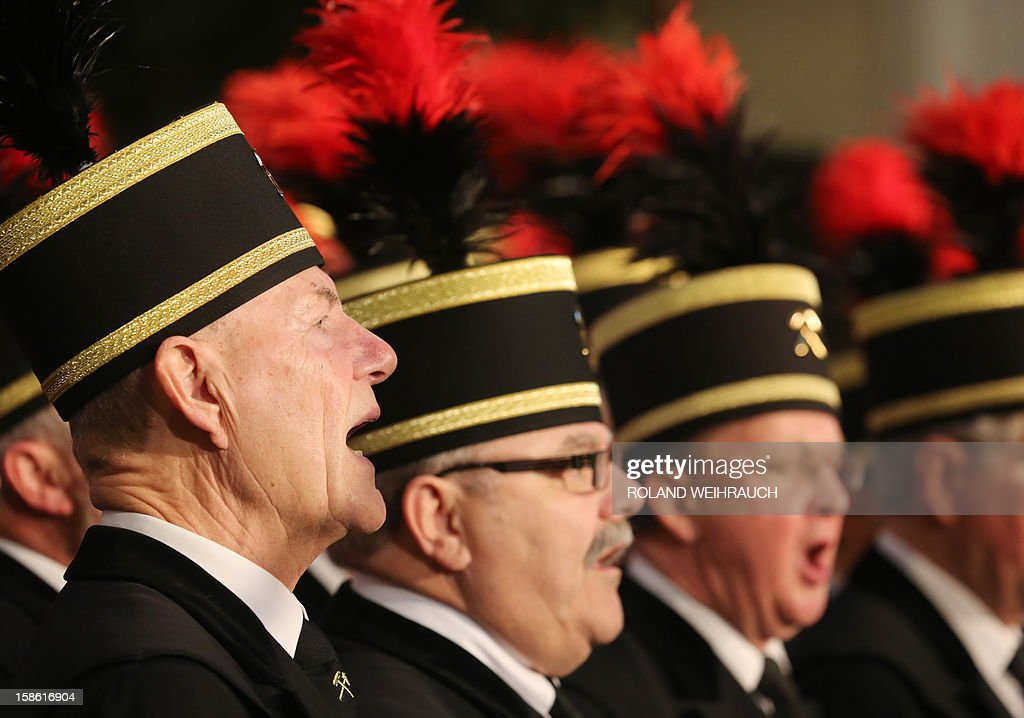 A miner choir performs during the closing ceremony after the very last mining shift at Mine West in Kamp-Lintfort, western Germany, on December 21, 2012. The mine will be shut down after being active for around 100 years.