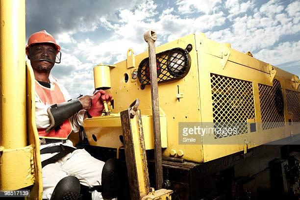 Miner driving a mining locomotive