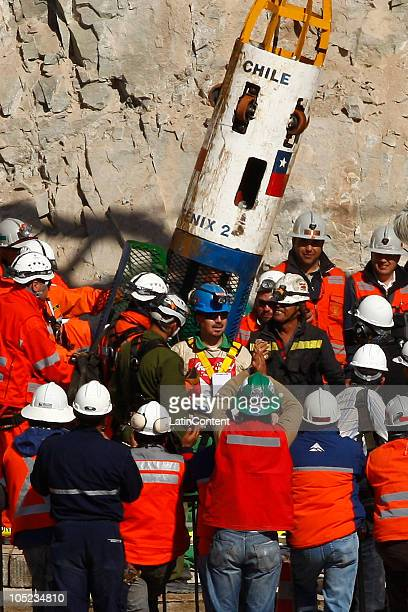 Miner Edison Pena reacts after arrive in the surface during the rescue operation of 33 miners trapped 700 meters underground for two months in the...
