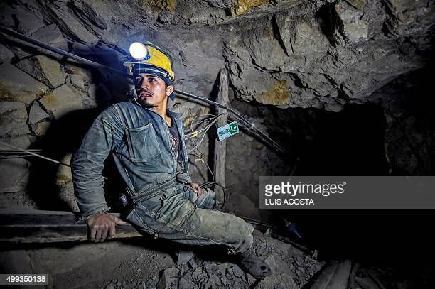 Miner Edison Rosero gets ready for a 100mdescent at 'La Corte' gold mine in La Llanada Narino department on October 20 2015 La Llanada miners extract...
