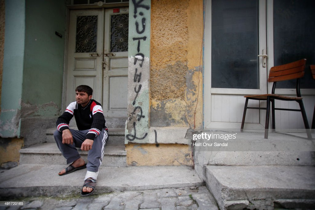 Miner Erdal Bicak who survived the mine accident in Soma sits looking dejected in Turkey's western province of Manisa May 17 2014 Manisa Governorate...