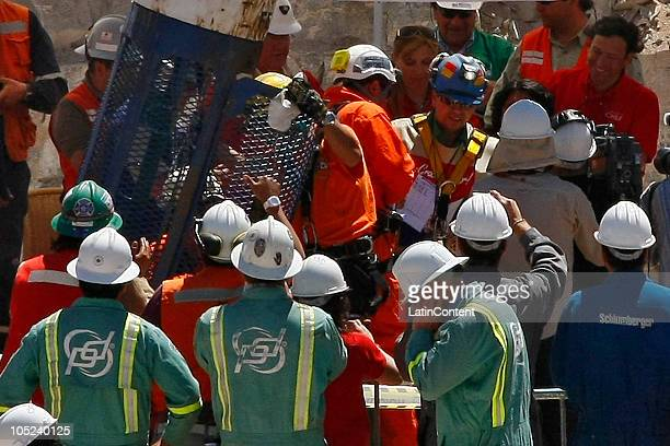 Miner Esteban Rojas arrives at the surface during the rescue operation of 33 miners trapped 700 meters underground for two months in the San Jose...