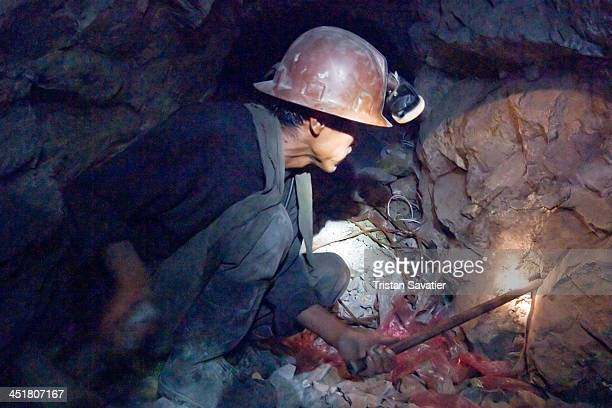 CONTENT] Miner handhammering a steel chisel to drill a small blasting hole in the old Candelaria silver mine in Potosi After about 5 hours of...