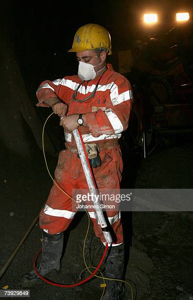 A miner handles explosives at the construction site for the Gotthard Base Tunnel on April 19 2007 near Sedrun Switzerland Deep beneath the Alps the...
