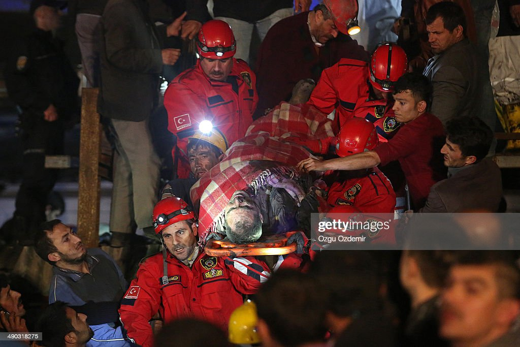 A miner is carried to an ambulance by rescue workers from the coal mine on May 14 2014 in Soma Manisa Turkey An explosion and fire in the coal mine...