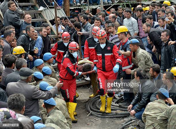 A miner is evacuated from the fire at a coal mine in the Soma district of Manisa Turkey on May 14 2014 An explosion and fire in the western Turkish...
