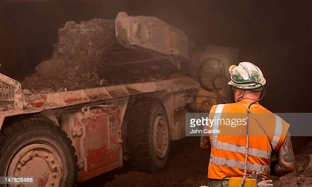 Miner John Jones operates a continuous mining machine stripping potash ore from the face 7km out under the North sea at Boulby mine on May 21 2012 in...