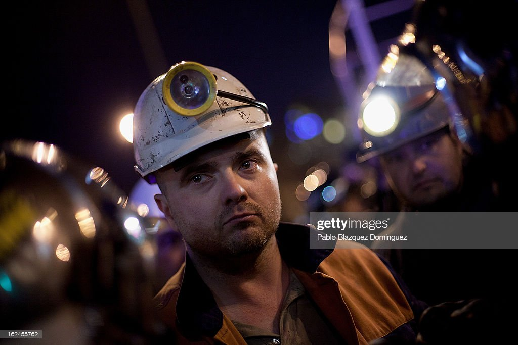 A miner looks on at Neptuno Square during a march by thousands of people on February 23, 2013 in Madrid, Spain. Public health workers, civil servants and disaffected citizens converged on central Madrid to protest against the austerity measures of Prime Minister Mariano Rajoy.