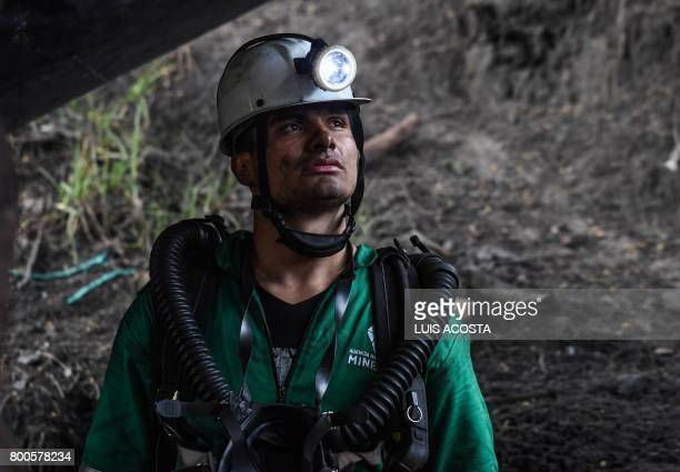 A miner looks on during search operations after an explosion at the El Cerezo illegal coal mine killed at least eight people in the rural area of...